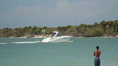 Planing Power Boat in Wiggins Pass, Naples, Florida